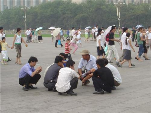 men in Asia squatting