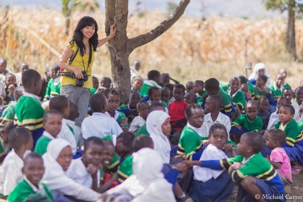 Elley Ho preparing to shoot an interview with an Asante Africa teacher
