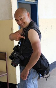 Heward Jue showing off his tan line after 10 days of shooting in Africa. Photo by Erna Grasz.