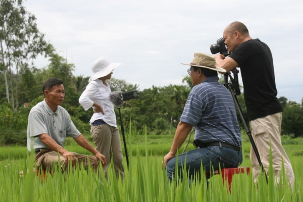Heward Jue capturing a story from a man in Vietnam