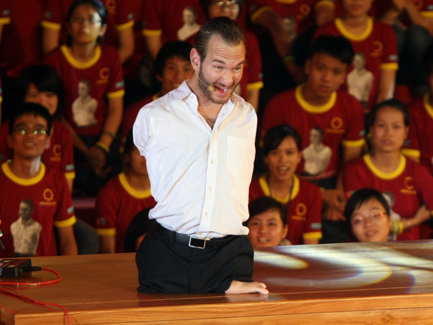 Australian evangelist and motivational speaker, Nick Vujicic, who was born with no limbs, speaks to a crowd.