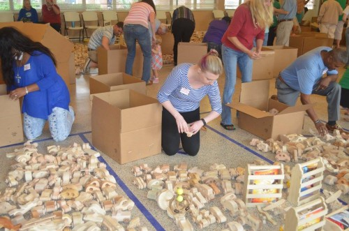 Jax Woodworkers club members lay out all the wood toys to prepare for pick up.
