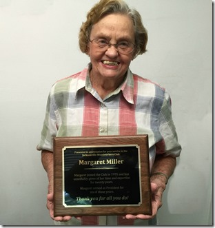 Margaret Miller holding an award she received in recognition for all her years leading Jax Woodworkers Club. The plaque was presented to her at the club's June 2015 meeting.